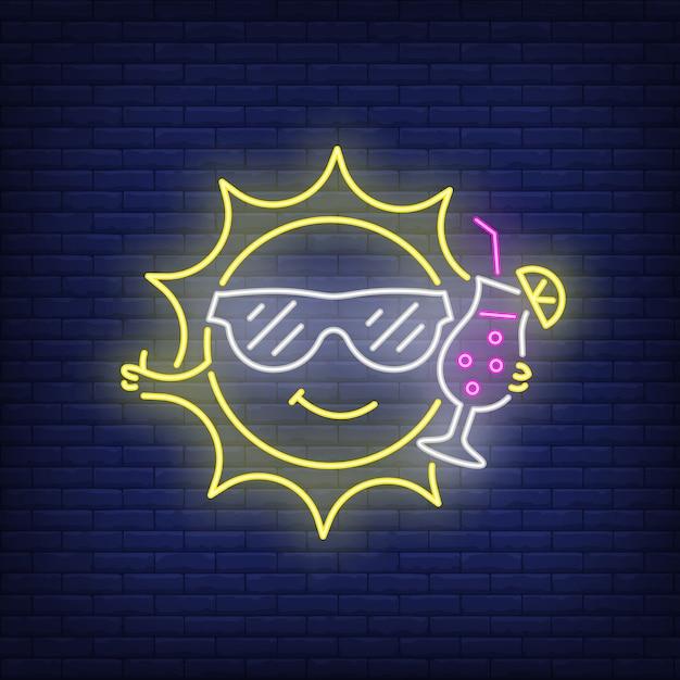 Cartoon sun drinking cocktail neon sign Free Vector