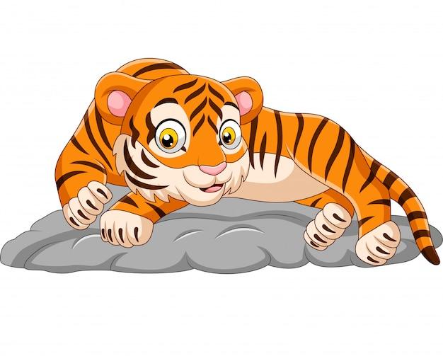 Cartoon tiger laying down on stone Premium Vector