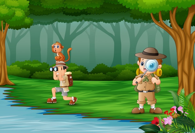 Cartoon two boys explorer in a forest Premium Vector