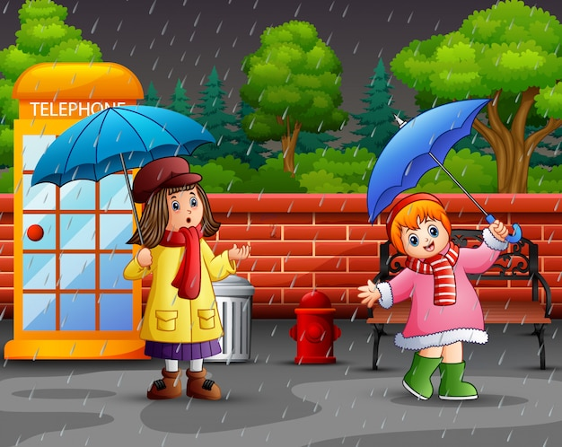 Cartoon two girl carrying umbrella Premium Vector
