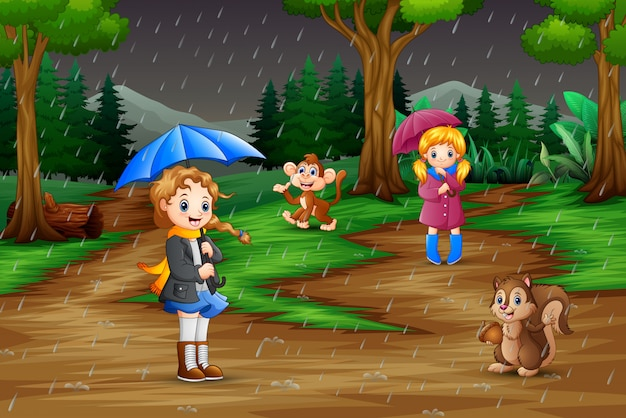 Cartoon two girl playing with animals under the rain Premium Vector