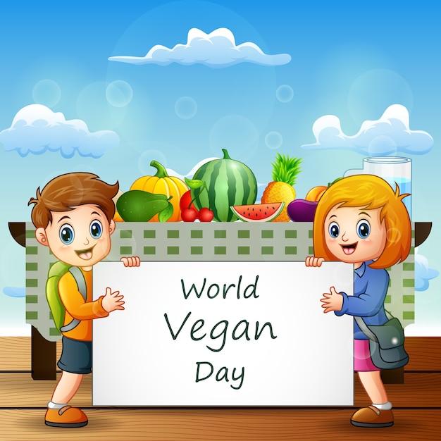 Мультфильм двое детей с табличкой с текстом всемирного дня вегана Premium векторы