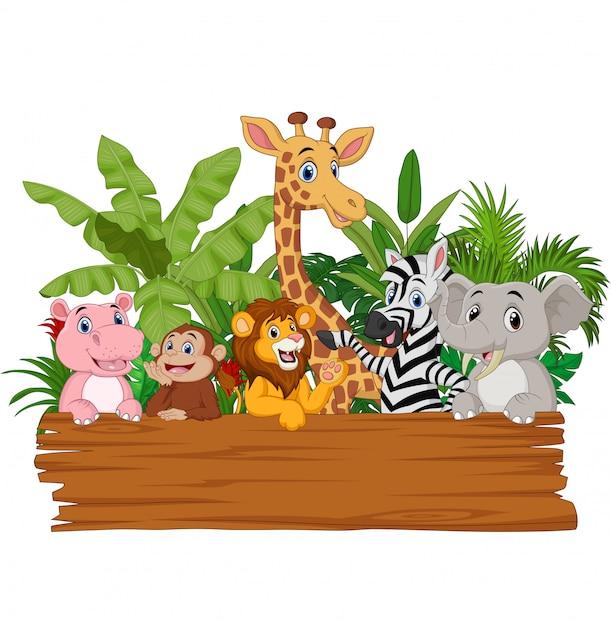 Cartoon wild animals holding blank board Premium Vector