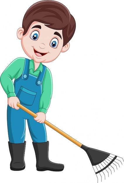 Cartoon young farmer working with a rake Premium Vector