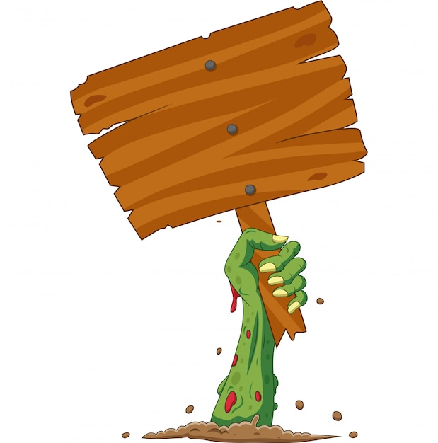 Cartoon zombie hand out of the ground holding blank sign Premium Vector