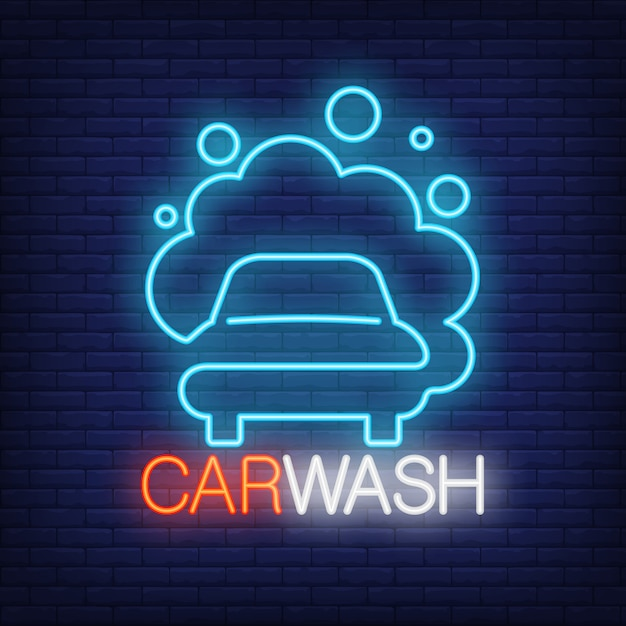 Carwash neon word and automobile in foam logo. neon sign, night bright advertisement Free Vector