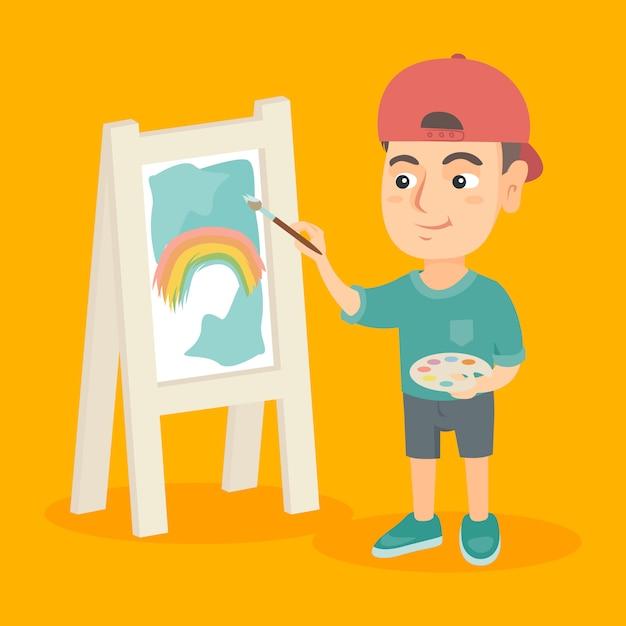 Caucasian boy artist painting picture on a canvas. Premium Vector