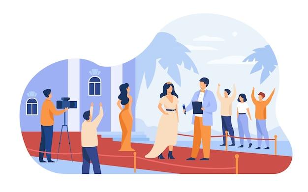 レッドカーペットに沿って歩く有名人は、フラットのベクトル図を分離しました。漫画の有名人がパパラッチカメラにポーズします。 無料ベクター