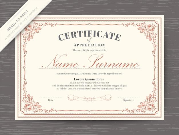 花のボーダーとフレームの証明書賞の卒業証書のテンプレート Premiumベクター