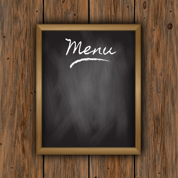 Chalkboard menu on a wooden background Free Vector
