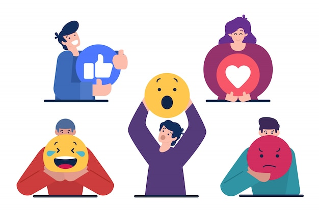 Characters holding emoticon sign Premium Vector