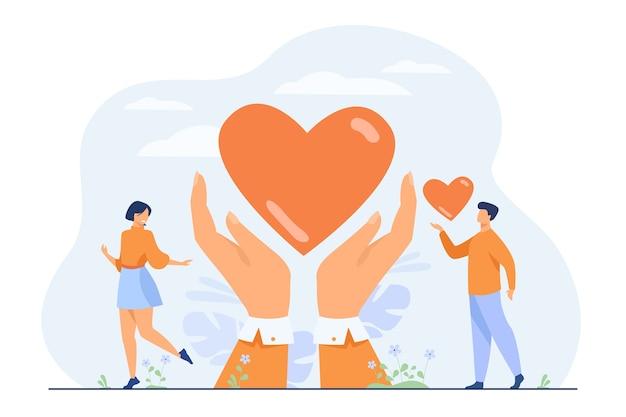 자선 및 기부 개념. 자원 봉사자의 손을 잡고 마음을주는. 무료 벡터