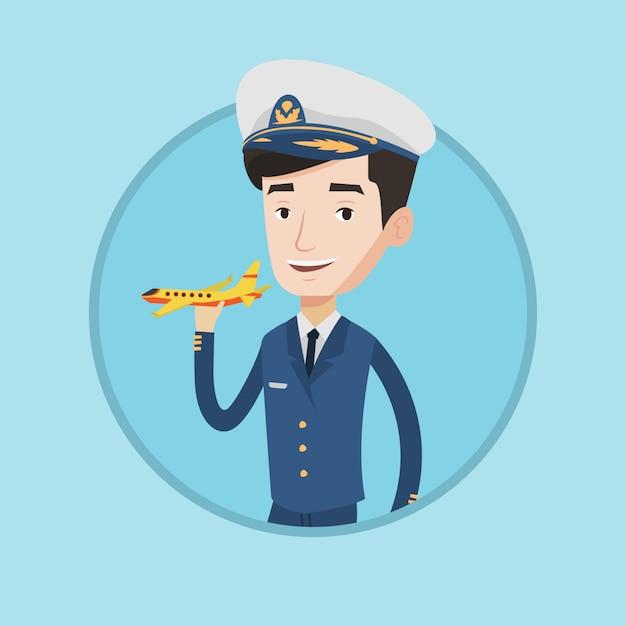 Жизнерадостный летчик авиалинии с модельным самолетом. Premium векторы