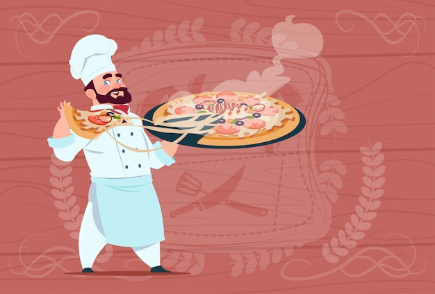Chef cook holding pizza smiling cartoon chief in white restaurant uniform over wooden textured background Premium Vector