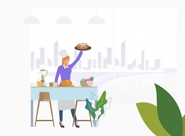 Chef cooking dinner at kitchen table and holding pie Free Vector