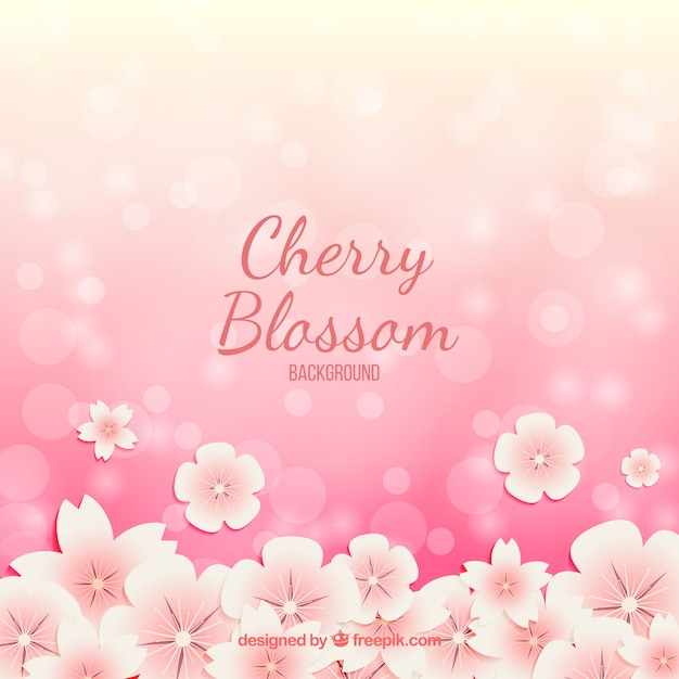 Cherry blossom background with bokeh effect Free Vector