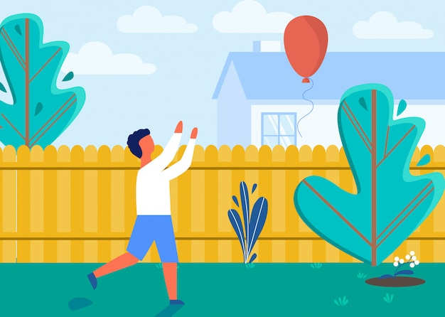 Child playing on house backyard with balloon. Premium Vector