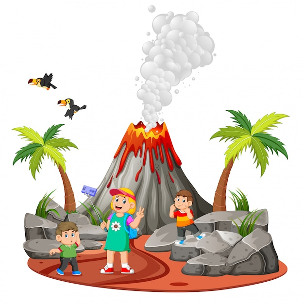 The children are doing holiday and taking a picture near the volcano Premium Vector