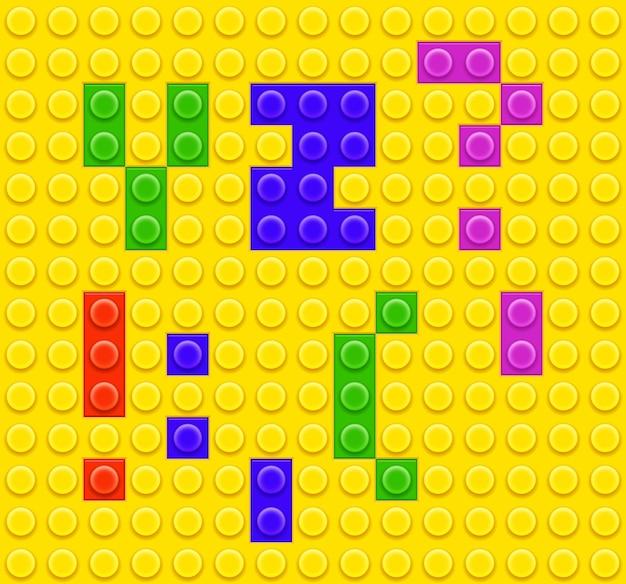 Alfabeto e simboli dei giocattoli del mattone dei bambini Vettore gratuito