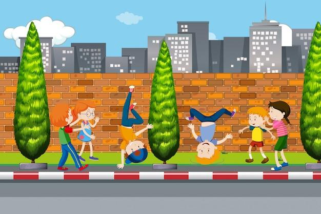 Children dancing on street Premium Vector