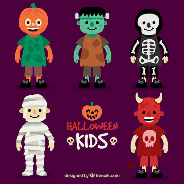 Children dressed up for a halloween party Free Vector