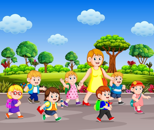 Children going to school with their teacher walking on the street in the sunny day Premium Vector