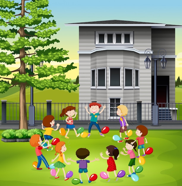 Children playing balloon popping in the park Premium Vector