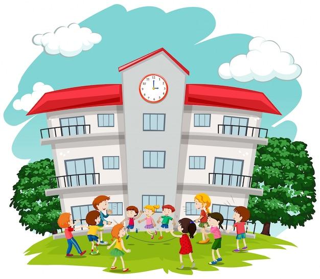 Children playing in front of school Premium Vector