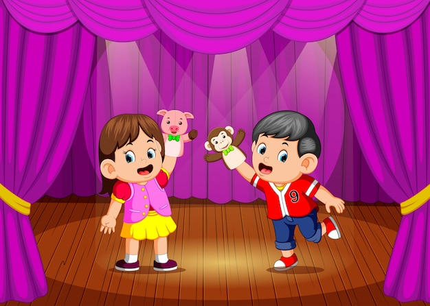 The children playing puppet in the stage Premium Vector