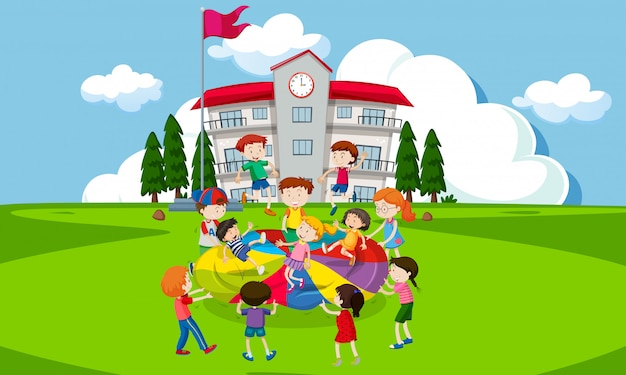 Children playing with a parachute infront of school Premium Vector