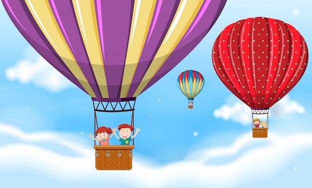 Children riding hot air balloon Free Vector