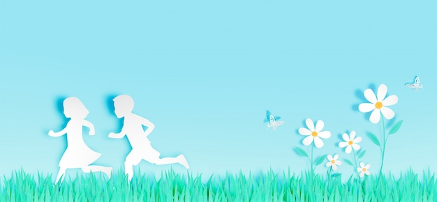 Children run among beautiful flowers with grass field in paper art style vector illustration Premium Vector