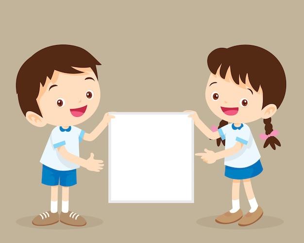Children's presentation.cute student boy and girl holding board presenting. Premium Vector
