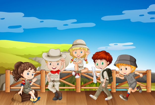 Children in safari costume on the bridge Free Vector