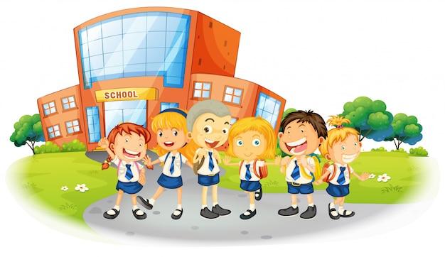 Children in school uniform at school Free Vector