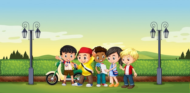 Children standing in the park Free Vector