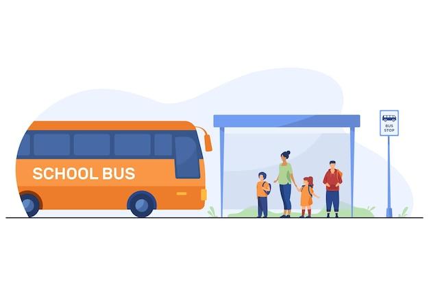 バス停でバスを待っている先生と子供たち 無料ベクター