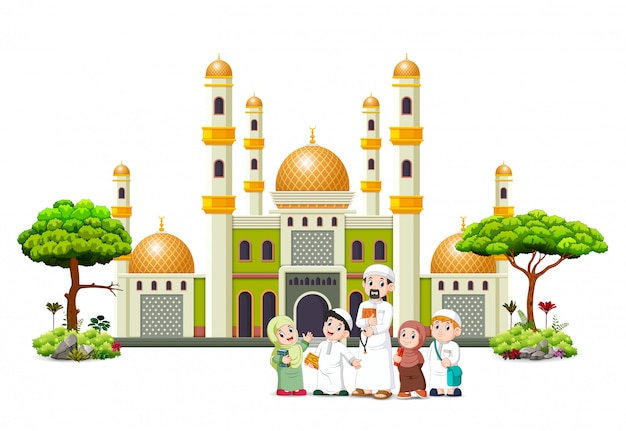The children with their father are posing in front of the green mosque Premium Vector