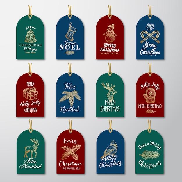 クリスマスと新年のすぐに使えるゴールデンキラキラギフトタグまたはラベルテンプレートセット。 無料ベクター