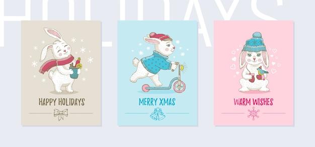 クリスマスの動物のグリーティングカード、ポスターセット。かわいいポスター、落書きスケッチバニーウサギ、引用スローガン。 Premiumベクター
