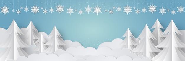 冬に降る雪と松の木と雪の結晶のクリスマスの背景デザイン Premiumベクター