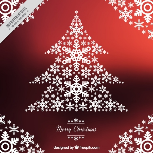 Christmas background of tree made with\ snowflakes