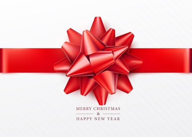クリスマスの背景。赤いリボンとリボンが付いた白いギフトボックス。上面図。あいさつテキストサイン。メリークリスマスと新年あけましておめでとうございます。 無料ベクター