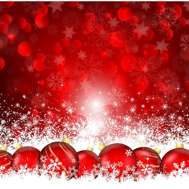 Christmas balls on the snow red\ background