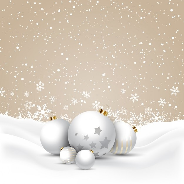 Christmas baubles nestled in snow\ background