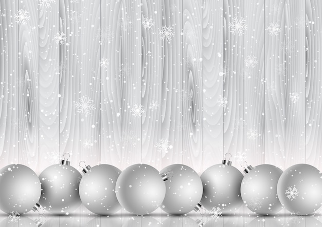 Рождественские шары на декоративной снежинке и деревянном фоне Premium векторы