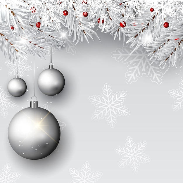 Christmas baubles on silver branches Free Vector
