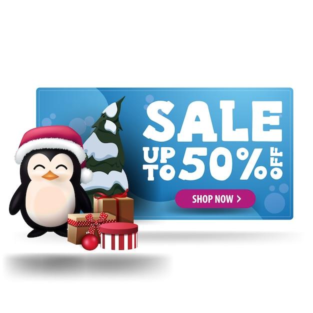 プレゼント付きサンタクロース帽子の紫色のボタンとペンギンとクリスマスブルー割引バナー Premiumベクター