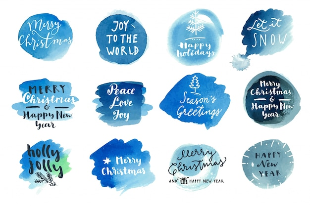 クリスマスの書道の挨拶の上に青い水彩の斑点 Premiumベクター