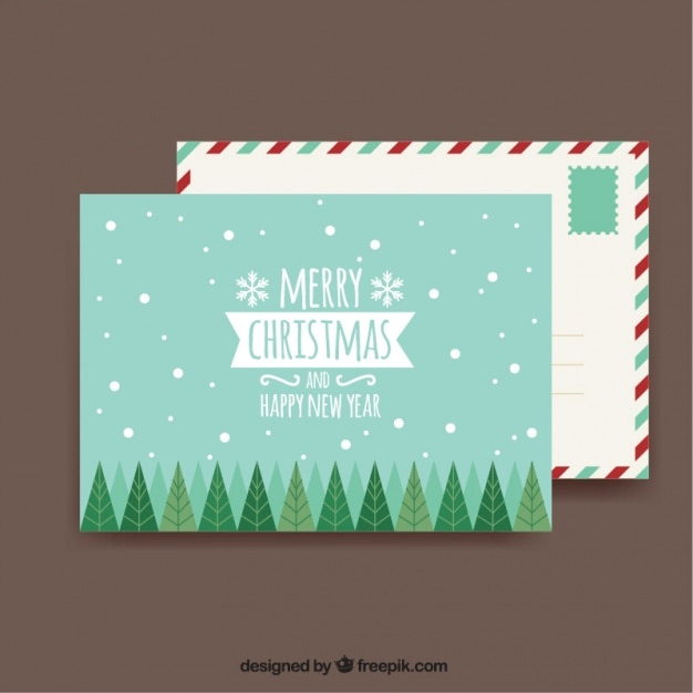 Christmas card and decorative envelope Free Vector